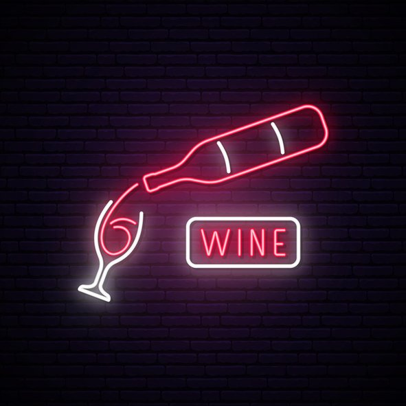 "Neon sign in a bar that reads ""wine"""